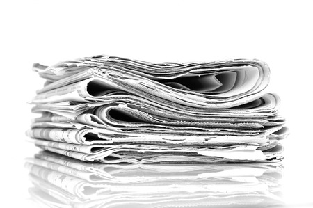 Stacked newspapers photo