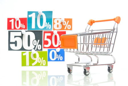 adverts: Discount - orange colored shopping cart with multicolored percent newspaper adverts