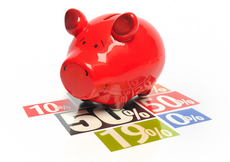 sales bank: Saving money - red piggy bank on multicolored newspaper percentage advertisements