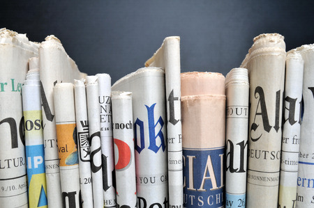 newspaper reading: Row of newspapers Editorial