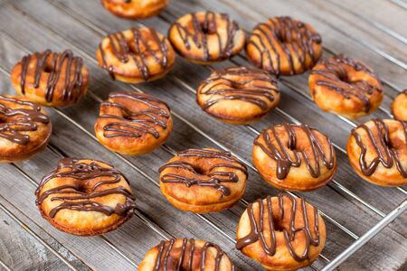 napkin ring: donuts with chocolate on wooden background
