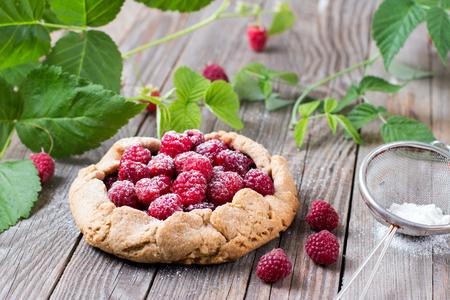 Summer delicious dessert blueberry galette on a wooden background