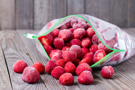 Frozen strawberries in a bag on the table Stockfoto
