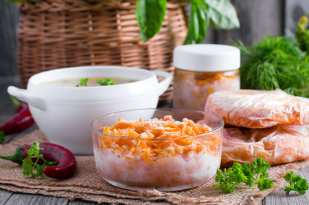 Frozen vegetables in containers Stock Photo