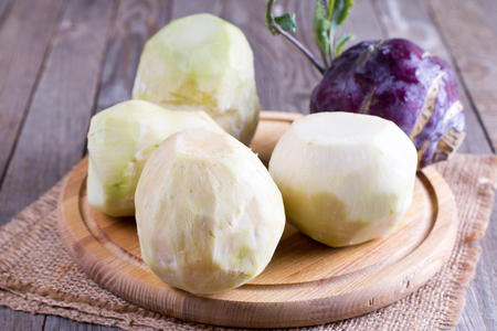 Cutting a kohlrabi on a wooden table