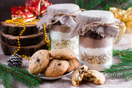 Chocolate chips cookies ingredients in a glass jar