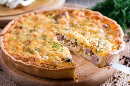 A piece of French quiche Lorraine 스톡 콘텐츠