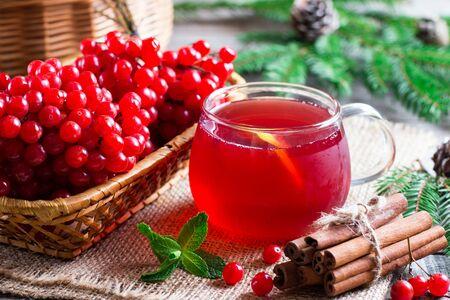 Hot tea viburnum. Tea viburnum in a glass cup on a table