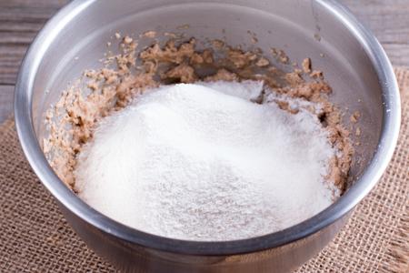 Food preparation. Add flour to the dough Stock Photo