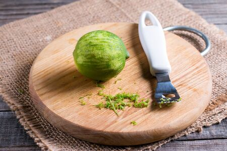 Lime zest on a cutting board Stock Photo