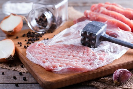 Raw chops on a cutting board Stock Photo