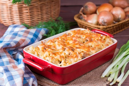 Mac and cheese, american style macaroni pasta in cheesy sauce. Homemade cheesy pasta Stock Photo
