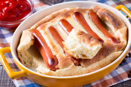 English food: toad in the hole into a baking dish on the table. Horizontal 写真素材