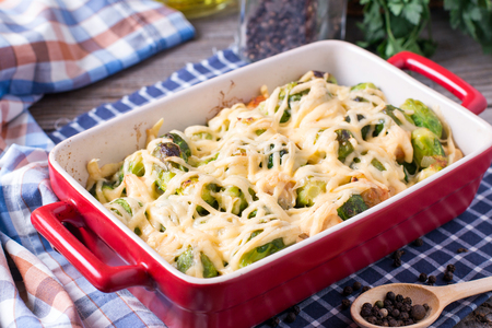 Brussels sprouts baked in sauce with cheese in a form Standard-Bild