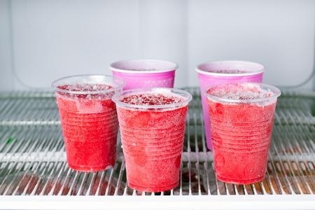 Frozen berry puree in the freezer. Frozen food