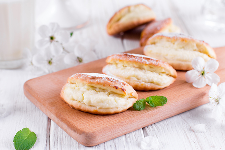 Cottage cheese cookies on white wooden background