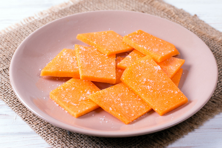 Sliced pumpkin with salt on a plate, food close up