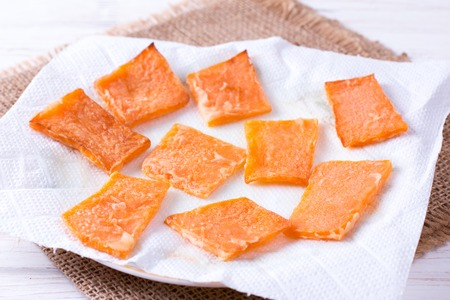 Slices of roast pumpkin on a paper napkin, food close up