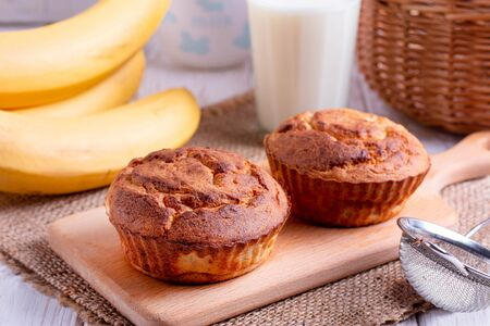 Homemade banana muffins on the wooden table. Horizontal