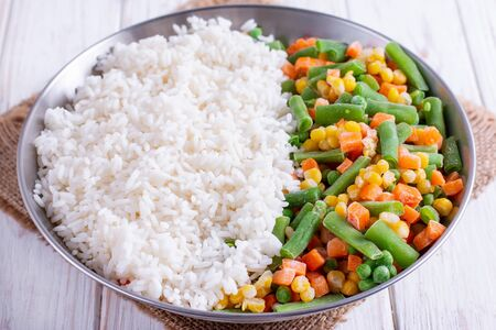 Homemade frozen vegetables with rice in a metal bowl Banco de Imagens