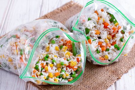 Frozen mixed vegetables in freezer bag. Frozen vegetable mix with rice