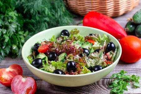 Fresh vegetable salad with olives in a bowl Stock Photo