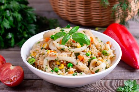 Fried squid with rice and vegetables in a bowl