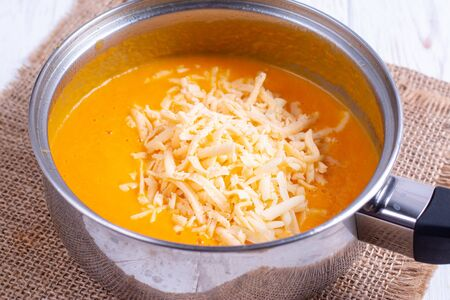 Pumpkin or carrot pureed for soup with blender, horizontal