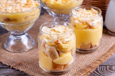 Dessert in a glass jar. Cream and dough. Dessert Napoleon