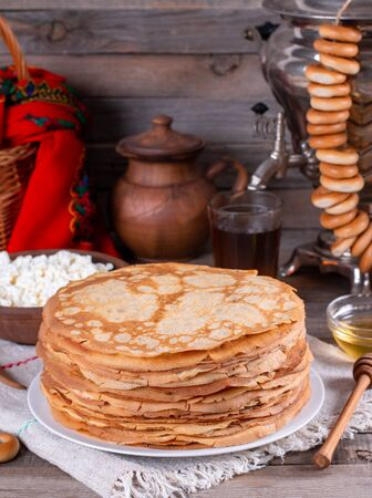 Thin homemade pancakes. Russian bliny. Maslenitsa. Rustic style, close up view Foto de archivo - 137827308