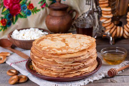 Thin homemade pancakes. Russian bliny. Maslenitsa. Rustic style, close up view Foto de archivo - 137827238