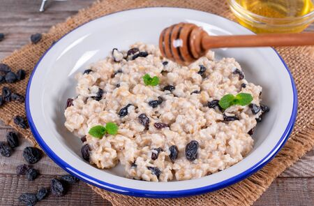 Bowl of oatmeal with raisins. Delicious oatmeal.