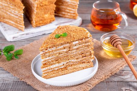 Homemade honey cake on a table, selective focus