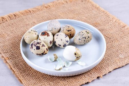 Quail eggs on a gray background. Easter eggs. Easter holiday.