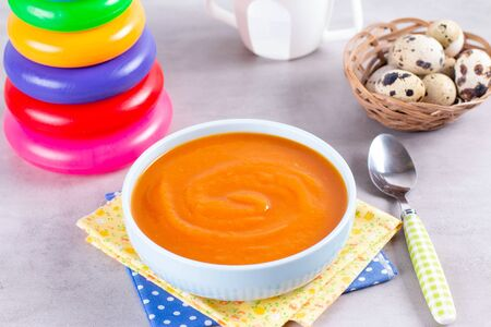 Pumpkin baby soup puree. The concept of baby food. Selective focus.