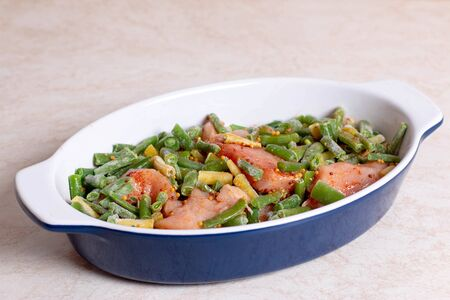 Green beans and chicken in a baking dish, diet food