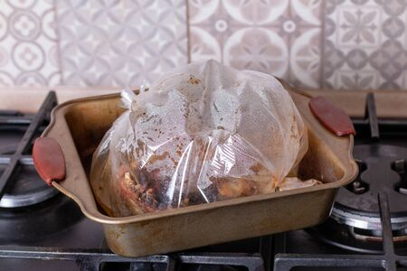 Baked chicken cooked in the oven in a sleeve