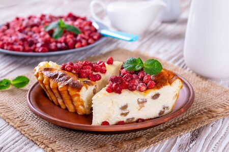 Cottage cheese bake cake casserole with berries in a plate