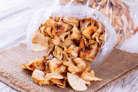 Dried apples in a plastic bag on the table Archivio Fotografico
