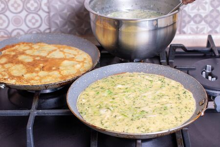 Delicious thin pancake in frying pan on stove, closeup Archivio Fotografico