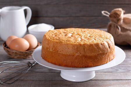 Homemade ideal sponge cake on wooden table. Homemade bakery concept