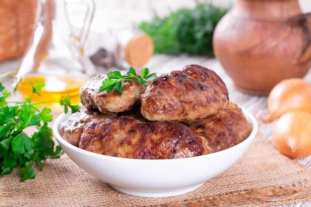 Homemade delicious meat cutlets in plate on a table