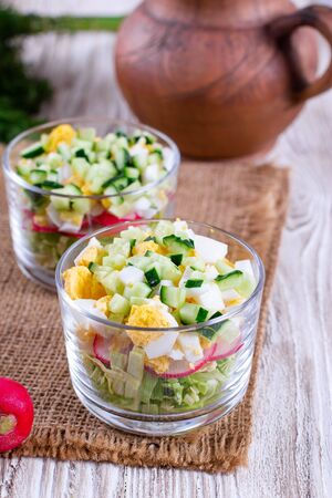 Fresh vegetable salad with egg, cabbage, radish and cucumber