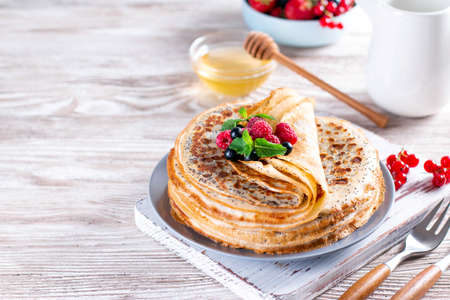 Crepes with berries and poppy seeds. healthy food. Maslenitsa - a traditional Russian and Ukrainian holiday