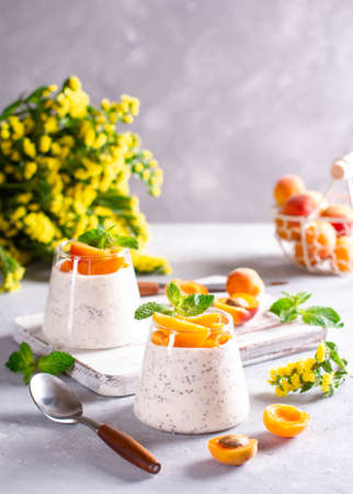 Healthy chia pudding with yogurt and fruit in a glass