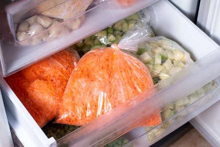 Frozen vegetables in bags in refrigerator, Frozen Carrot, closeup Foto de archivo
