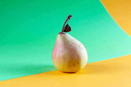 Organic fresh pear on green yellow background, modern style food picture