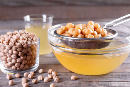 Boiled chickpea and aquafaba. Egg replacement for vegan recipe. Vegan cooking concept. Healthy product.