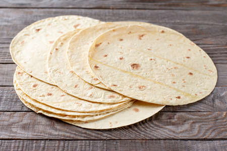 Mexican corn tortillas for sentencing tacos, quesadilla, fajitos, tortilla on a wooden table