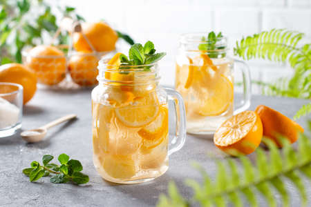 Fresh summer cocktail with lemons, mint and ice. Refreshing summer drink.